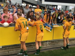The Matilda's team signing autographs for fans