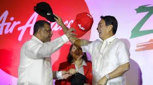 Tony Fernandes with his signature cap presentation