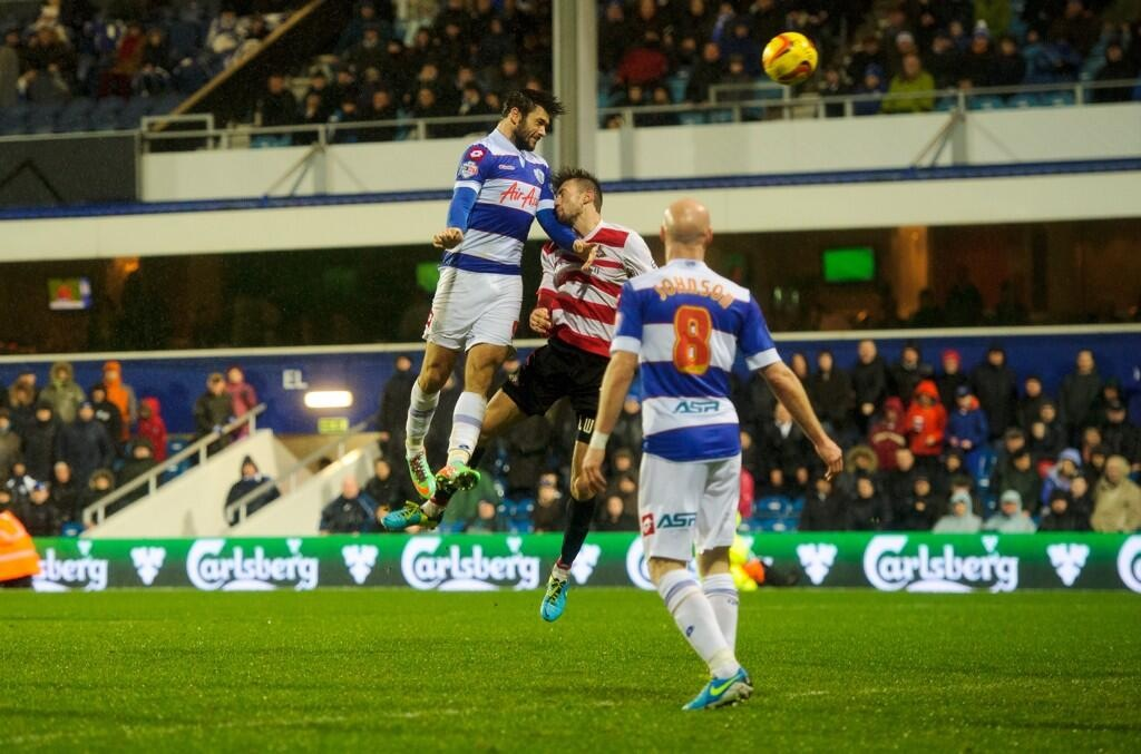 Charlie Austin heads home the winner in QPR's 2-1 over Doncaster
